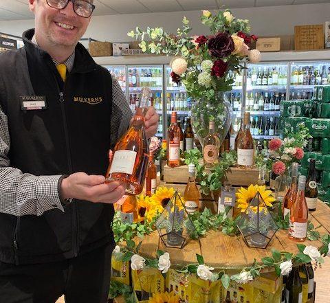 Shane with Bottle of Elixir Rose