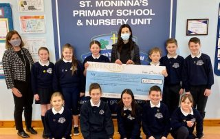 Isobel Temple, Principal Cloughogue PS and pupils receive Cash Prize of £250 from Kelly McKeown, Mulkerns SPAR / Eurospar