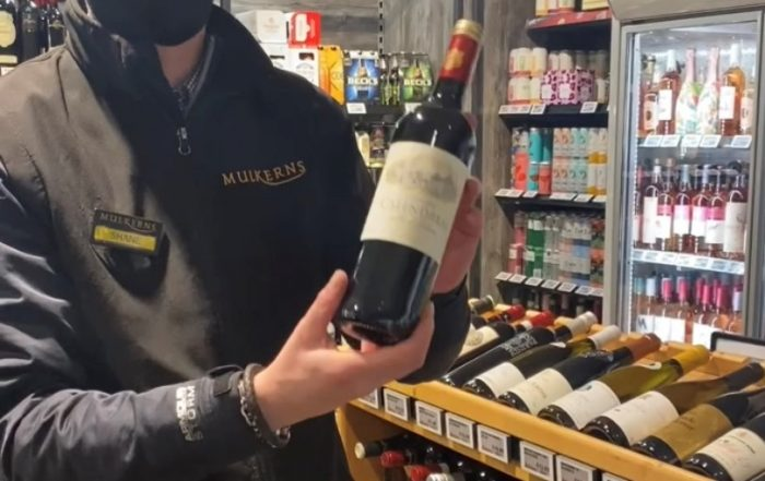 Shane with a bottle of Chateau Calendreau In Store